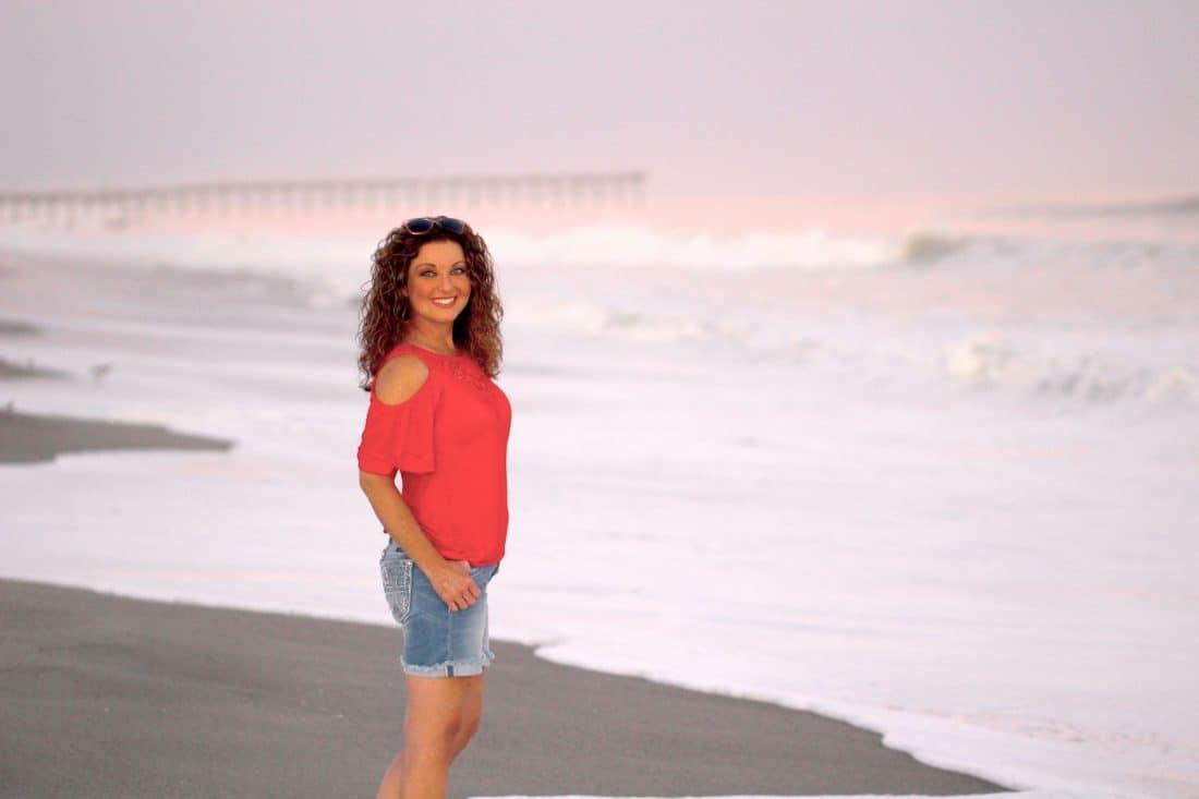 Melody walking beach sunset