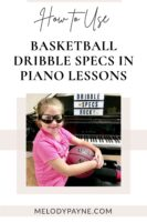 Cute piano student holding a basketball and wearing basketball dribble glasses