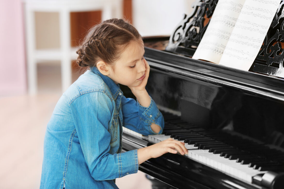 Tired piano student who doesn't want to practice the piano