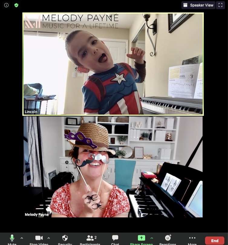 Young online piano student playing dress up the teacher